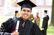 College graduate with diploma (iStockphoto)